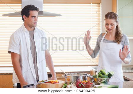 Young couple having a disagreement in the kitchen