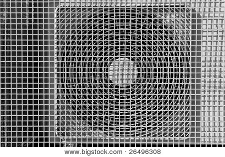 Air conditioning ventilation fan with a mesh grill cover.