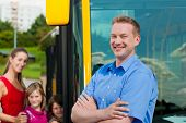 stock photo of bus driver  - Passengers boarding a bus at a bus station - JPG