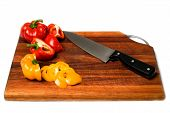 Bell Peppers On Wood Cutting Board. poster