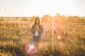 Girl Closed Her Eyes, Praying Outdoors, Hands Folded In Prayer Concept For Faith, Spirituality And R poster