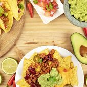 An Overhead Photo Of An Assortment Of Many Different Mexican Food Dishes, Including Tacos, Guacamole poster
