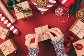 Christmas Background With Gift Boxes, Clews Of Rope, Papers Rools And Decorations On Red. Preparatio poster