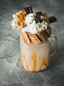 Chocolate Milkshake With Dripping Sauce, Cream, Waffle And Candy Bar poster