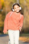 Keep A Song In Your Heart. Little Girl Listen To Music. Little Music Fan On Autumn Day. Happy Little poster