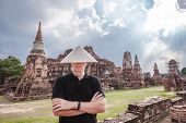 Man In Chinese Hat Standing Near The Ancient Ruins At Wat Mahathat In Ayutthaya Historical Park At A poster