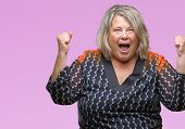 Senior plus size caucasian woman over isolated background celebrating surprised and amazed for succe poster