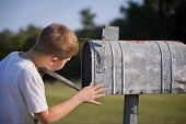A Cute Boy, Checking The Mail In An Open Mail Box. The Kid Is Waiting For The Letter, Checks The Cor poster