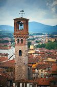Torre delle Ore clock tower in Lucca Italy poster