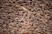 Weathered Sandstone Surface. Ancient Rough Texture Of Natural Stone. Porous Surface Closeup. Rustic  poster