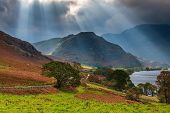 Sunbeams Over Rannerdale Knotts At Crummock Water, A Lake In The English Lake District Which Is Now  poster