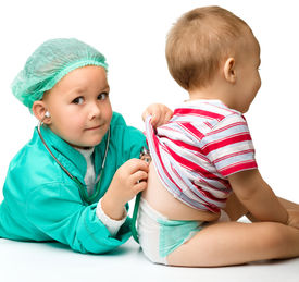 image of children playing  - Cute children are playing doctor with stethoscope - JPG