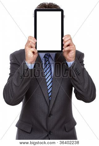 Businessman holding up a blank tablet pc in front of his face