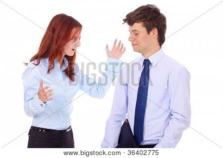 Young arguing angry businesswoman and businessman in blue shirts, isolated on white