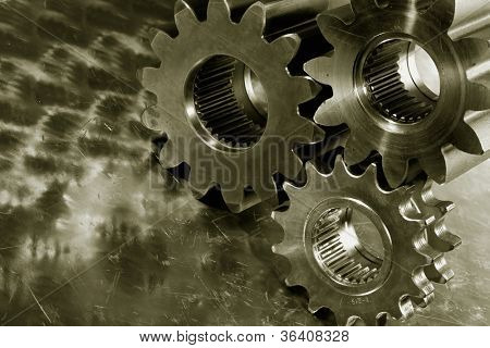 large steel gears and wheels against a titanium background, duplex bronze toning idea