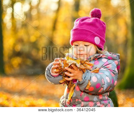 Little girl walking in the park