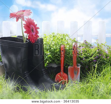 Gardening tools and flower on the grass
