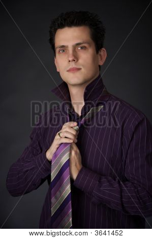 Adjusting His Tie