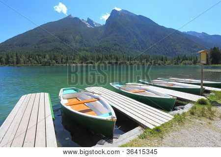 Boats on a beautiful alpine lake.  Hintersee Lake, Bavarian Alps in the Berchtesgaden National Park, Germany