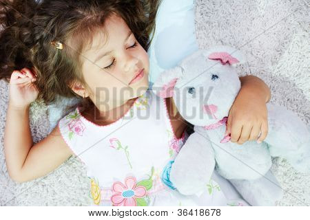 Portrait of lovely girl sleeping with teddybear