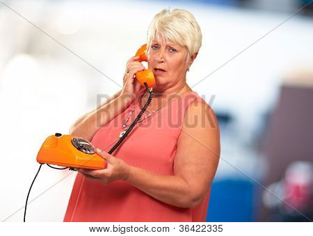 Portrait Of A Senior Woman Holding A Retro Phone, Background