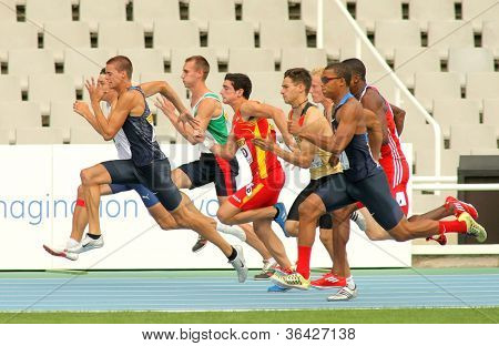 BARCELONA - JULY 10: Competitors on start of 100m of Decathlon  men during the 20th World Junior Athletics Championships at the Olympic Stadium on July 10, 2012 in Barcelona, Spain