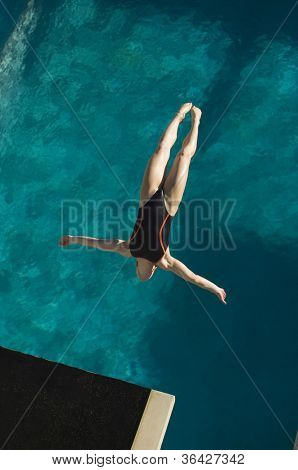 High angle view of a female diver in midair diving