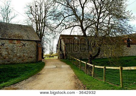 A Road Into A Farm