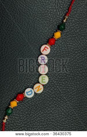 A friendship band isolated on a leather background