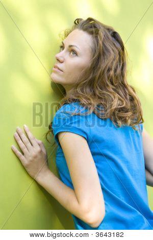 Beautiful Woman Near Wall