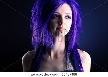 Portrait of a punk girl. Over black background.