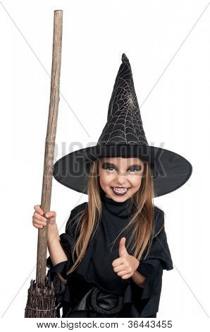 Portrait of little girl in black hat and black clothing with broom on white background
