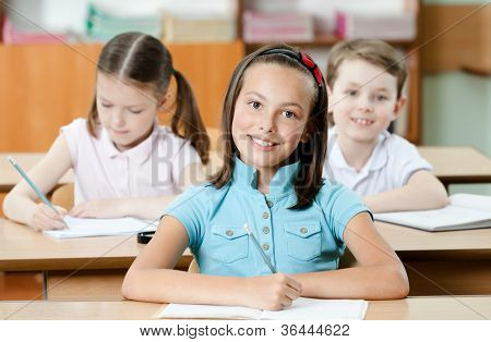 Pupils are are glad to study. They listen to every word of teacher