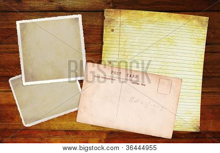 Wooden Background With Blank Old Notepaper And Photo Blanks.