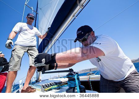 MEDITERRANEAN SEA, TURKEY- MAY 29: Unidentified sailor participates in sailing regatta Sail & Fun Trophy 2012 from Marmaris to Fethiye,  May 29, 2012 in the Mediterranean Sea, Turkey.