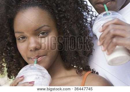 Close-up of an African American woman sipping milkshake