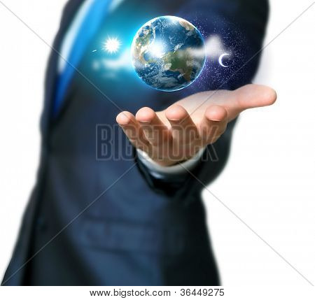 Human hand holding our planet earth glowing.Elements of this image furnished by NASA
