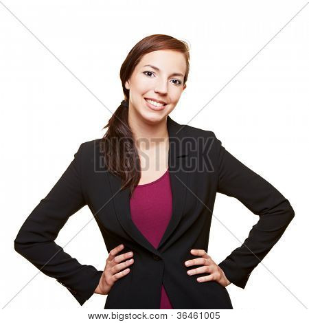 Smiling attractive business woman holding her arms akimbo