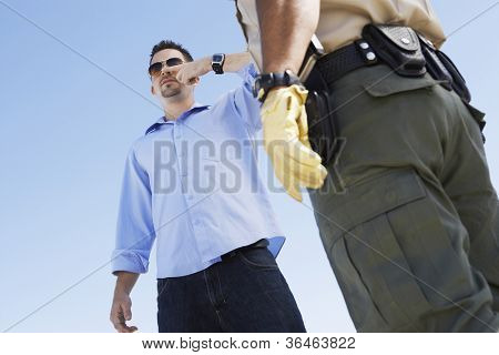 Young man with police officer from below