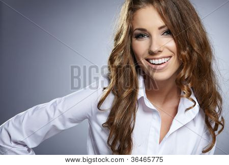 Smiling business woman. Isolated over grey  background