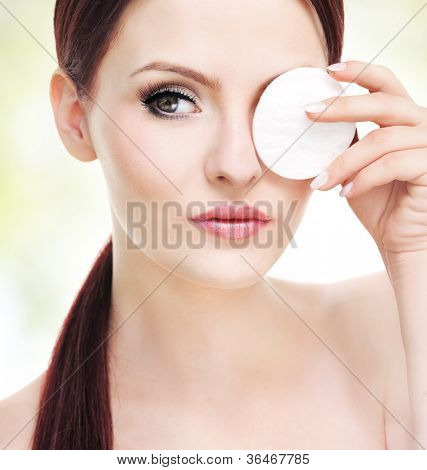Make up removal concept, beautiful young adult woman with cotton pad
