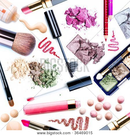 Makeup. Make-up Set.Collage.Mascara,lipgloss,lipstick,rouge,eyeshadows,eyeliner,foundation isolated on a white background
