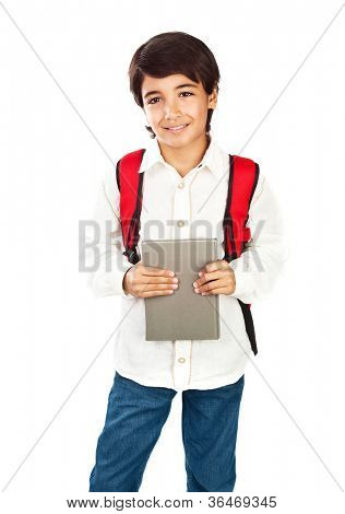 Happy schoolboy isolated on white background, cute brunet teenager with red backpack standing and holding book, pretty schoolkid wearing casual clothes, back to school, education and knowledge concept