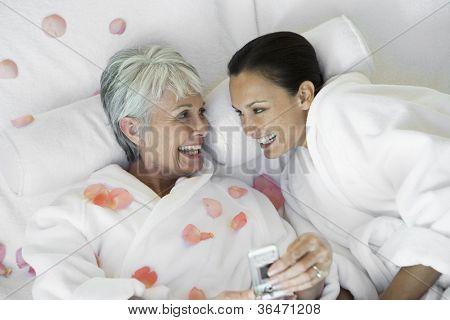 Happy women making cellphone call