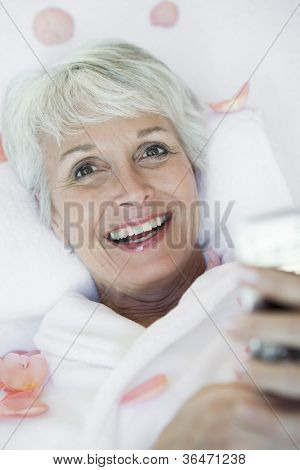 Happy woman making cellphone call