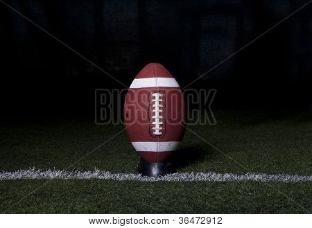 Football Kickoff on night background