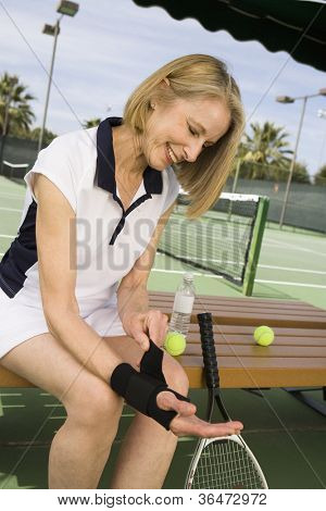 Senior tennis player wearing wristband