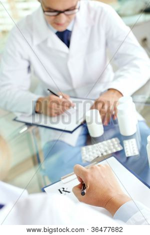 Image of practitioners prescribing tablets