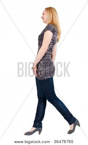 back view of walking woman . going blonde girl in motion. Rear view people collection.  backside view of person. Isolated over white background.