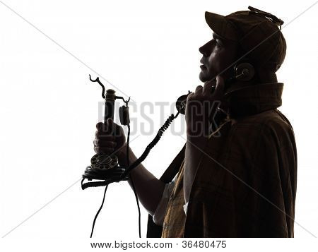 sherlock holmes silhouette on the phone in studio on white background